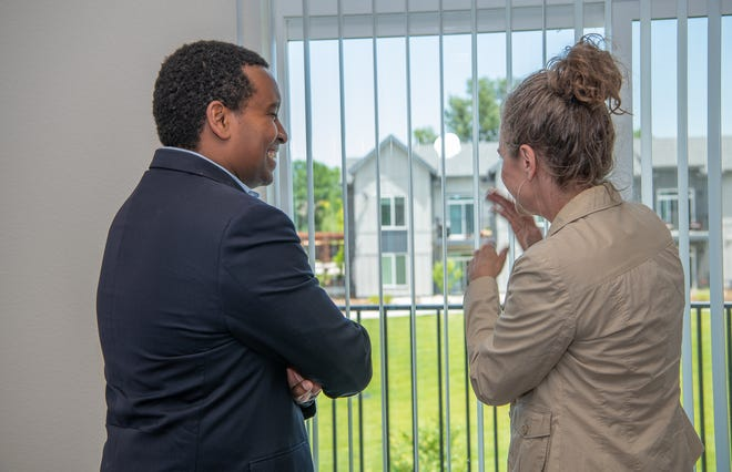 U.S. Rep. Joe Neguse stands with Housing Catalyst CEO Julie Brewen as they tour a three bedroom unit at the affordable housing development Village on Horsetooth, on Wednesday, July 3, 2019, in Fort Collins, Colo. Housing Catalyst has received 75 new vouchers to provide housing help to non-elderly residents with disabilities and those experiencing homelessness.