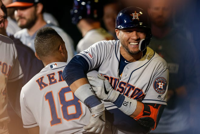 Jul 2, 2019; Denver, CO, USA; Houston Astros first baseman Yuli Gurriel (10) celebrates in the dugout with Tony Kemp (18) after hitting a two run home run against the Colorado Rockies in the seventh inning at Coors Field. Mandatory Credit: Isaiah J. Downing-USA TODAY Sports
