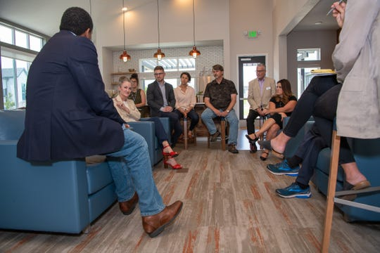 U.S. Rep. Joe Neguse speaks with attendees from Fort Collins Housing Catalyst prior to a tour of the Village on Horsetooth, an affordable housing development, on Wednesday, July 3, 2019, in Fort Collins, Colo.