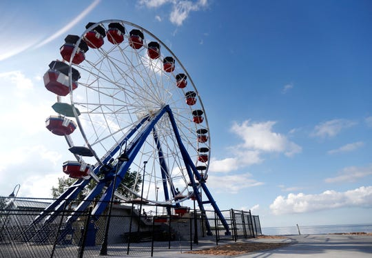 The Big Wheel's opening day Tuesday at Bay Beach Amusement Park in Green Bay.