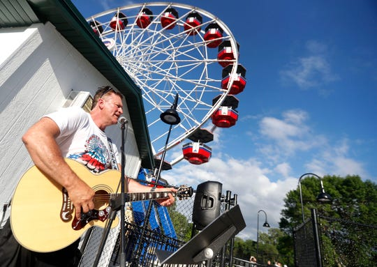 Frank Hermans, of Green Bay, performs during the opening of the Big Wheel Tuesday, July 2, 2019 at Bay Beach Amusement Park in Green Bay, Wis.