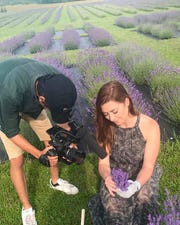 The Discover Wisconsin crew gets up close to Fragrant Isle's lavender plants.
