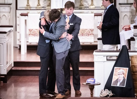 MacRae Few, brother of Thomas Few, and Hudson Davis, Thomas' roommate, embrace after speaking at a memorial for Thomas at Buncombe Street United Methodist Church Wednesday, July 3, 2019. Thomas Few was a rising junior studying construction science and management at Clemson University, who died at the age of 20 after falling from the roof of a garage at a home in Clemson just after midnight Sunday, June 30.