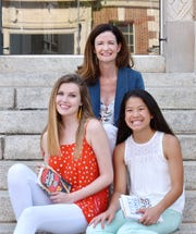 Lee Yarborough with her two children Caroline, 17, and Josie, 12, outside of M. Judson Booksellers in downtown Greenville.