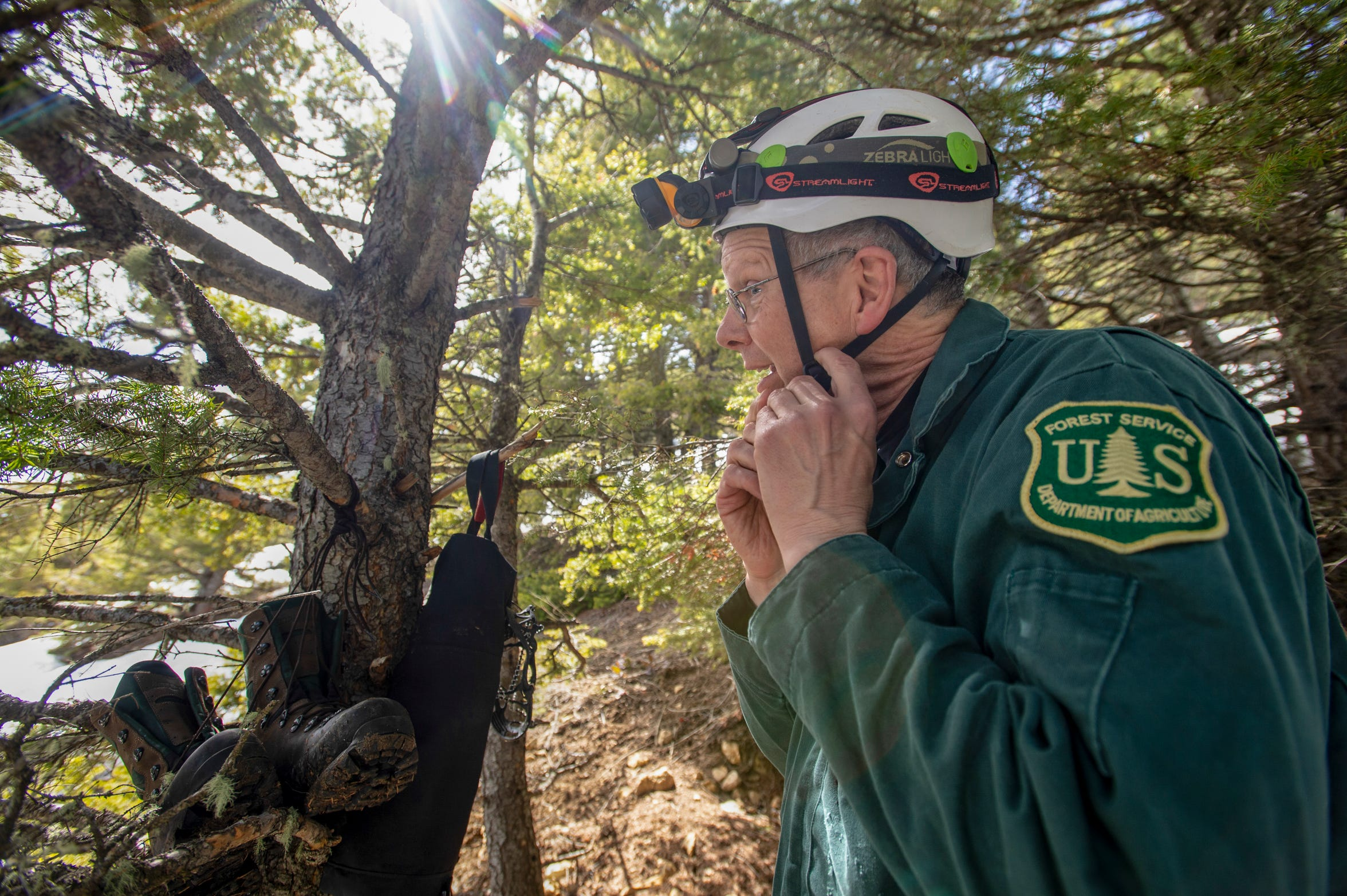 Dave Bobbitt, geologist with the U.S. Forest Service, prepares to enter Lick Creek Cave in the Helena-Lewis and Clark National Forest to study the bat population.