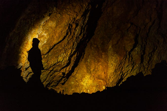 Lauri Hanauska-Brown, chief of Montana Fish, Wildlife Parks' Non-game Wildlife Management Bureau, searches for bats in Lick Creek Cave to sample for a deadly fungus called white-nose syndrome.