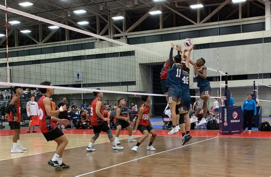 Aiden McDonald explodes through a triple block against the Vegas Elite 18 Gold team at the 2019 USAV Boys Junior National Volleyball Championships in Dallas.