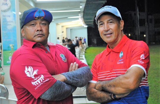 John-Anthony Muna, left, and Robert Manalo are senior members of Team Guam at the XVI Pacific Games in Samoa.