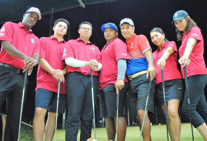 "In this file photo from July 2019, Guam's representatives to the Pacific Games in Samoa take time for a photo during a team practice at the Tumon Driving Range. Pictured from left are team captain Daryl Poe, Ricardo Terlaje, Eduardo ""Pollo"" Terlaje, John-Anthony Muna, Robert Manalo, Emeri Satake and Rose Tarpley. Not pictured is Kristin Oberiano."
