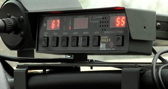 Indiana State Trooper Cedric Merritt clocks motorists traveling on I-465 on Wednesday, March 21, 2007. Today's radar can be used through the front of the cruiser as well as clocking people from the rear of the car while in motion.
