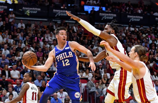Apr 9, 2019; Miami, FL, USA; Philadelphia 76ers guard T.J. McConnell (12) controls the ball against Miami Heat forward Justise Winslow (20) during the first half at American Airlines Arena.