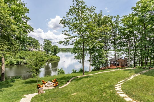 The home at 4545 McCurdy Road has fire pit and boathouse overlooking Eagle Creek.