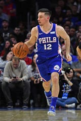 Mar 28, 2019; Philadelphia, PA, USA; Philadelphia 76ers guard T.J. McConnell (12) during the second quarter against the Brooklyn Nets at Wells Fargo Center.