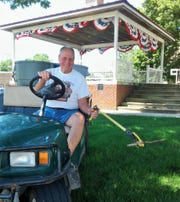 With his utility golf cart, Beef Days T-shirt and heavy-duty grabber, Marv Stastny is familiar around Solon as the town's unofficial, volunteer, one-man sanitation department. Here he patrols the park bandstand downtown.