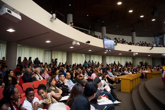 Attendees at Knoxville's third naturalization ceremony of the year wait for it to begin at the City County building in Knoxville, Wednesday, July 3, 2019. 120 people from 48 countries were naturalized.