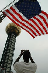 Jeff Cohran takes a photo for his photography class at UT during Festival on the Fourth at World's Fair Park.