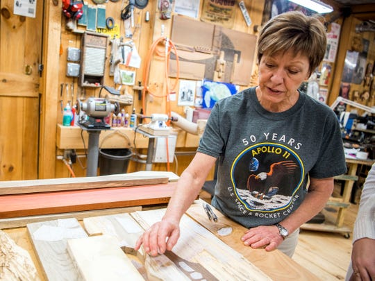 Intarsia artist Judy Gale Roberts in her woodworking studio in Seymour on Wednesday, July 3, 2019. Roberts created a commemorative intarsia woodwork piece for the 50th anniversary of the Apollo 11 moon landing that will be displayed in the Kennedy Space Center in Florida