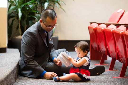 Ardel Gorospe plays with his 11-month-old daughter Ella, after being naturalized at Knoxville's third naturalization ceremony of the year, at the City County building in Knoxville, Wednesday, July 3, 2019. 120 people from 48 countries were naturalized.