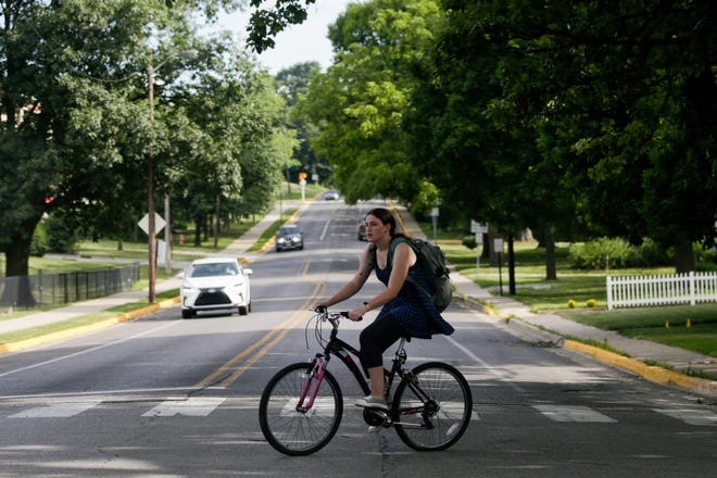 A bicyclist rides along Grant st., Wednesday, July 3, 2019 in West Lafayette.