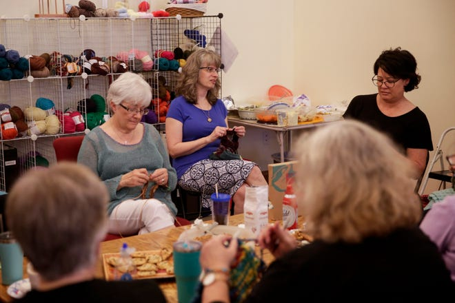 Elizabeth Thomas Ladd, center, knits with a group of charity knitters at River Knits Fine Yarns, Wednesday, July 3, 2019 in Lafayette. After 16 years, River Knits Fine Yarns closed their doors on Wednesday.