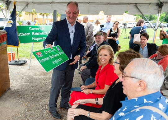 "Louisiana Gov. John Bel Edwards presents former Gov. Kathleen Blanco a sign designating part of U.S. Highway 90 as ""Governor Kathleen Babineaux Blanco Highway"" at an unveiling ceremony Tuesday, July 2, 2019. The designated portion stretches from its intersection with Interstate 10 in Lafayette to its intersection with Louisiana Highway 308 in Raceland."