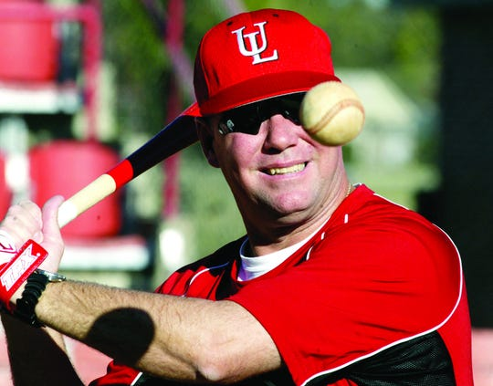 Coach Tony Robichaux hits balls to his pitchers as they practice in 2006.
