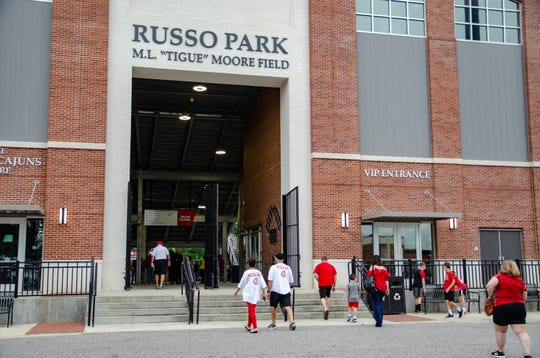 The University of Louisiana Lafayette holds a prayer vigil for UL head baseball coach Tony Robichaux at Russo Park Tuesday. Robichaux continues to battle for his life after two open-heart surgeries following a heart attack in June.