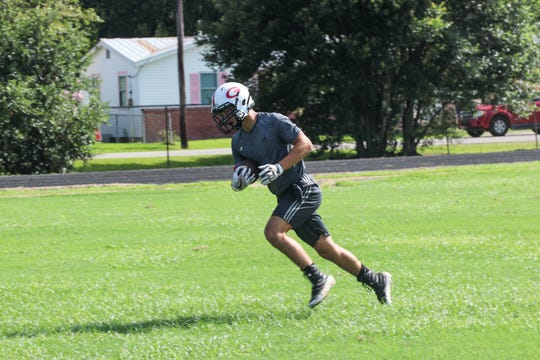 Gueydan fullback Lane Breaux runs with the ball during practice.