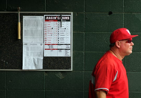 "UL Coach Tony Robichaux watches the action from the dugout at UL plays San Diego State in the NCAA Baseball Division I Regional Tournament Saturday, May 31, 2014, at M.L. ""Tigue"" Moore Field in Lafayette."