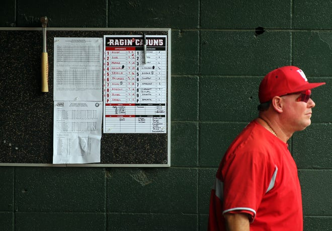 """UL Coach Tony Robichaux watches the action from the dugout at UL plays San Diego State in the NCAA Baseball Division I Regional Tournament Saturday, May 31, 2014, at M.L. """"Tigue"""" Moore Field in Lafayette."""