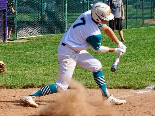 Evans Sines checks his swing during a recent game playing for the 17U Midwest Marlins.