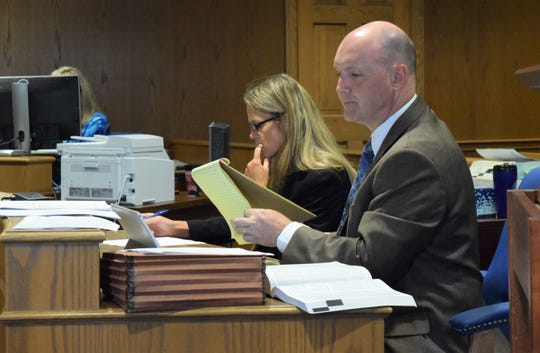 Chris Reamer, Fairfield County assistant prosecutor, examines his notes during Joseph Hodge's sentencing hearing Wednesday. A jury found Hodge guilty on eight felony counts in June. He was sentenced to 14 years in prison.