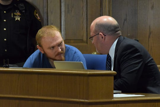 Joseph Hodge, left, discusses his case with Scott Wood, his defense attorney. Hodge was sentenced to 14 years in prison after a jury convicted him on eight felonies.