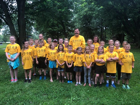 These students are pictured wearing their GOOD t-shirts, along with the founder of the GOOD program, Ron Derry.  Derry and his assistant, Amy, attended the picnic.