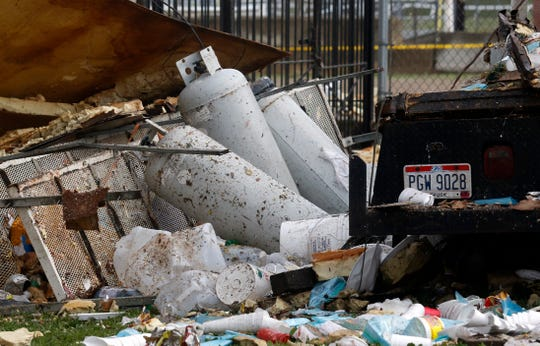 Propane tanks sit next to the a truck that exploded Wednesday morning, July 3, 2019, in Lancaster. The truck exploded at about 4:10 a.m. at the Fairfield County Fairgrounds. Fire investigators believe a propane leak inside the truck was ignited by an electrical spark setting off the explosion, shooting debris more than 100 feet away. No one was injured, but several buildings and food stands and trailers were damaged.