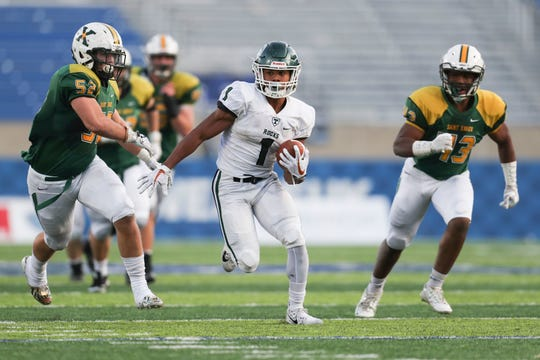 Rondale Moore The speedy Moore won the Paul Hornung and Gatorade Kentucky Player of the Year awards in 2017 after a sensational senior season, posting a school-record 109 receptions for 1,478 yards and 16 touchdowns while helping the Shamrocks go 15-0 and capture the Class 6A state championship. He also rushed for 537 yards and seven touchdowns on 50 carries and was selected to play in the U.S. Army All-American Game. As a freshman at Purdue in 2018, Moore earned All-American honors after catching 114 passes for 1,258 yards and 12 touchdowns and accumulating 2,215 all-purpose yards.