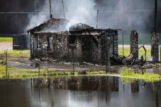 A Jim Beam warehouse, filled with about 40,000 bourbon barrels, was burning Wednesday morning after a fire started around 11:30 p.m. Tuesday at the facility in Woodford County.