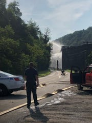 Crews attempt to put out a fire at a Jim Beam warehouse on July 3, 2019, in Versailles, Kentucky.