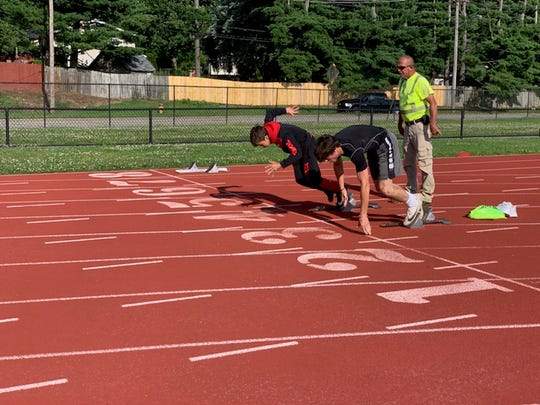 King Combest (red hoodie) training for the 2019 USATF Outdoor Region 5 junior Olympic Championships