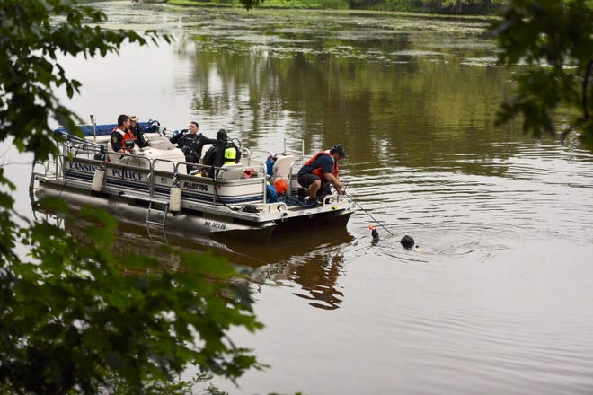 Search and rescue crews search the Grand River for a child who went missing Tuesday evening near Fulton Park in southwest Lansing.
