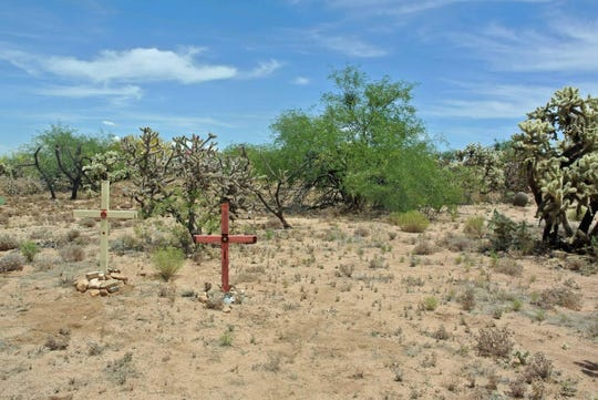 Two crosses mark the spot where the remains of migrant brothers were found in the desert at the U.S.-Mexico border.