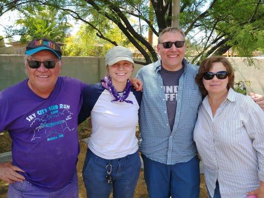 Artist Alvaro Enciso (from left), volunteer Maxie, Manitowoc pastor Matthew L. Sauer and volunteer Alicia at the U.S.-Mexico border.