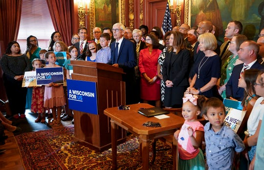 Wisconsin Gov. Tony Evers makes a statement before signing the budget at the state Capitol in Madison on Wednesday. Evers made 78 partial vetoes to the state budget passed by the Republican-controlled Legislature before signing it.