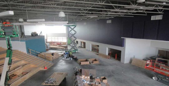 The new Meadow View Elementary School in Oconomowoc's cafeteria/commons area and social staircase are shown here under construction in early June.