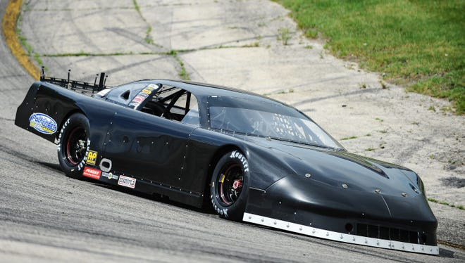 Matt Kenseth rounds Turn 2 at Slinger Speedway on Wednesday during a test session for the upcoming 40th Slinger Nationals on July 9.