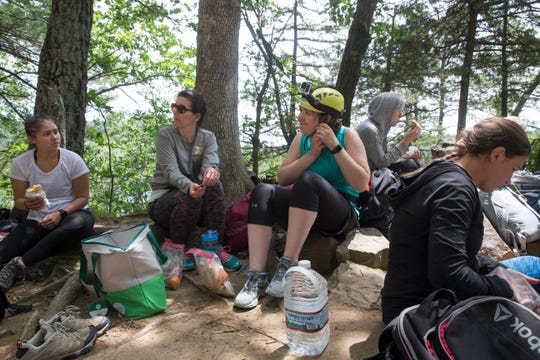 Participants with First Descents take a break for lunch while rock climbing at Devil's Lake State Park on June 22, 2019.