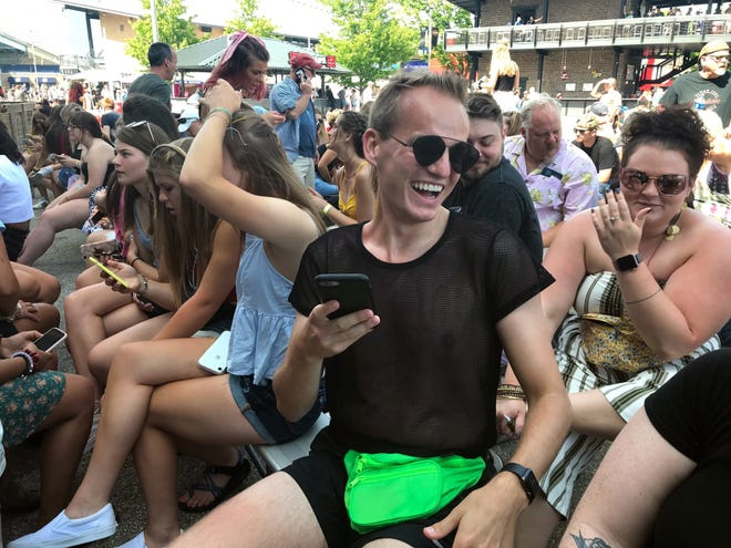 Wade Snowden was swiping on Grindr with his friends while waiting for Lizzo to perform at Summerfest on Thursday, June 27, 2019.