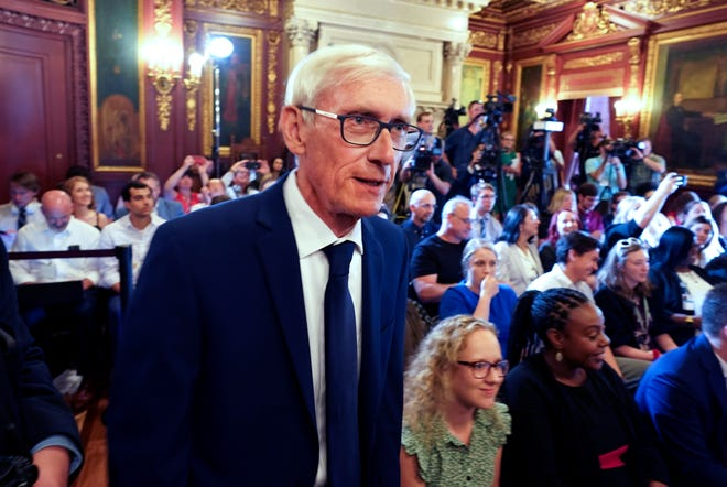 Wisconsin Gov. Tony Evers arrives to sign the budget at the state Capitol in Madison on Wednesday. Evers made 78 partial vetoes to the state budget passed by the Republican-controlled Legislature before signing it.