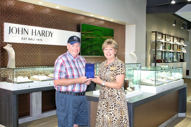 Lloyd Crull presented the winning ticket to become the lucky winner of theRed, White &Blue Festival Hearts on Firediamond-star pendant.The pendant wasdonated by Carter's Jewel Chest and all proceeds from the ticket sales help support the Red, White &Blue Festival.The Red, White &Blue Festival committee thanks all who purchased tickets supporting this great community event.