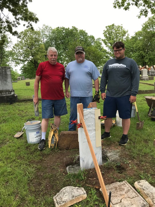 Paul Norell, Kevin Bodenhamer and Gabe Smith are shown after erecting a new headstone for Civil War veteran Joseph Bunnell at the Mountain Home Cemetery.